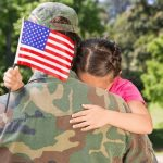 Mother soldier and child hugging in Fayetteville, NC