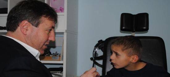 Dr. Harvey Richman performing eye exam at Shore Family Eyecare in Manasquan