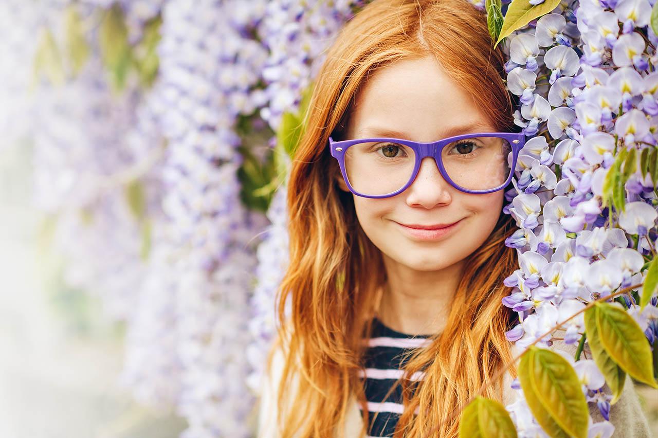 girl in purple glasses flowers
