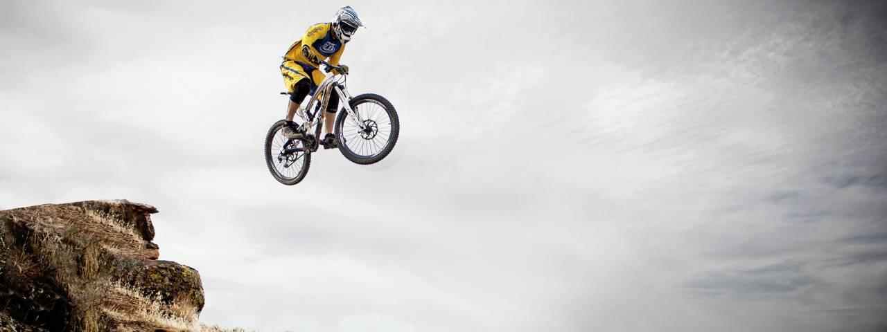 sports downhill biker jumping 1280x480