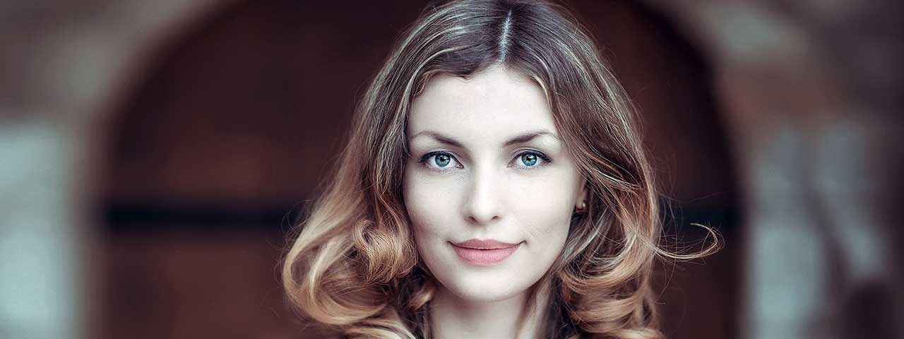 eye care, woman wearing multifocal contacts in Ancaster, ON