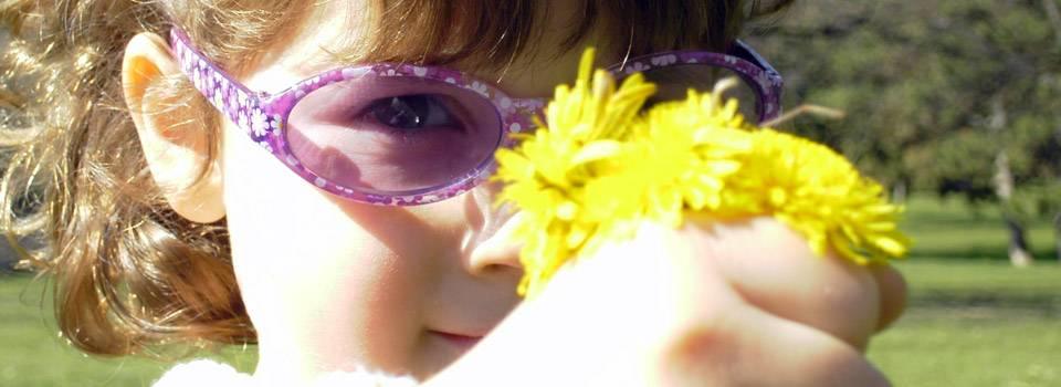 little-girl-carrying-dandelion