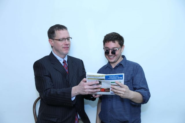 Dr. Cusic with a patient trying on low vision goggles