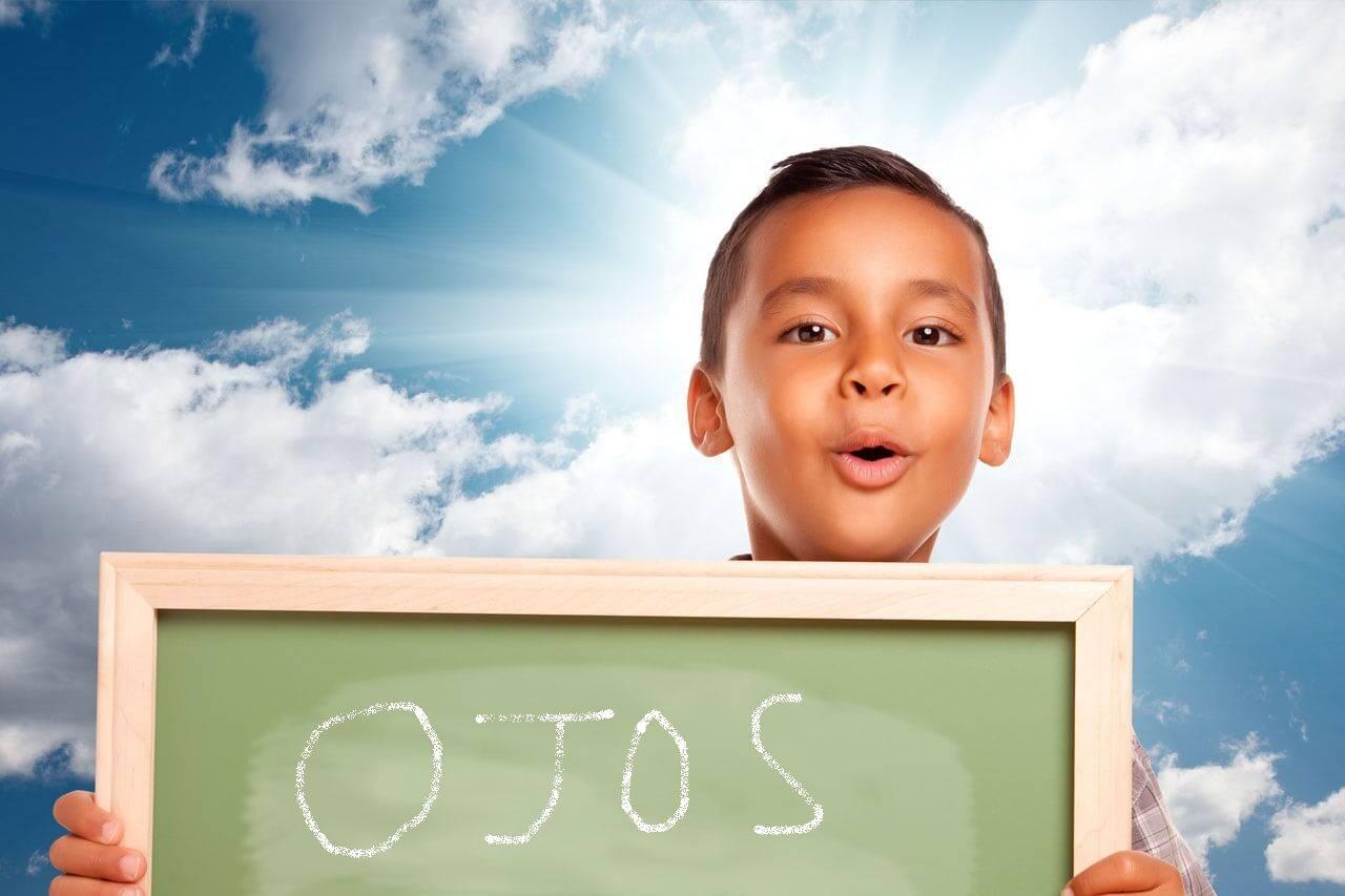 boy chalkboard ooohing hispanic