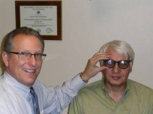 Eye doctor with his low vision patient