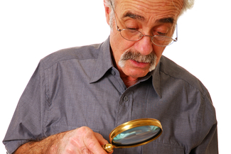 senior man magnifying glass1