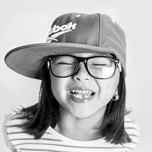Optometrist, Asian girl in glasses smiling in Oxford, Pennsylvania