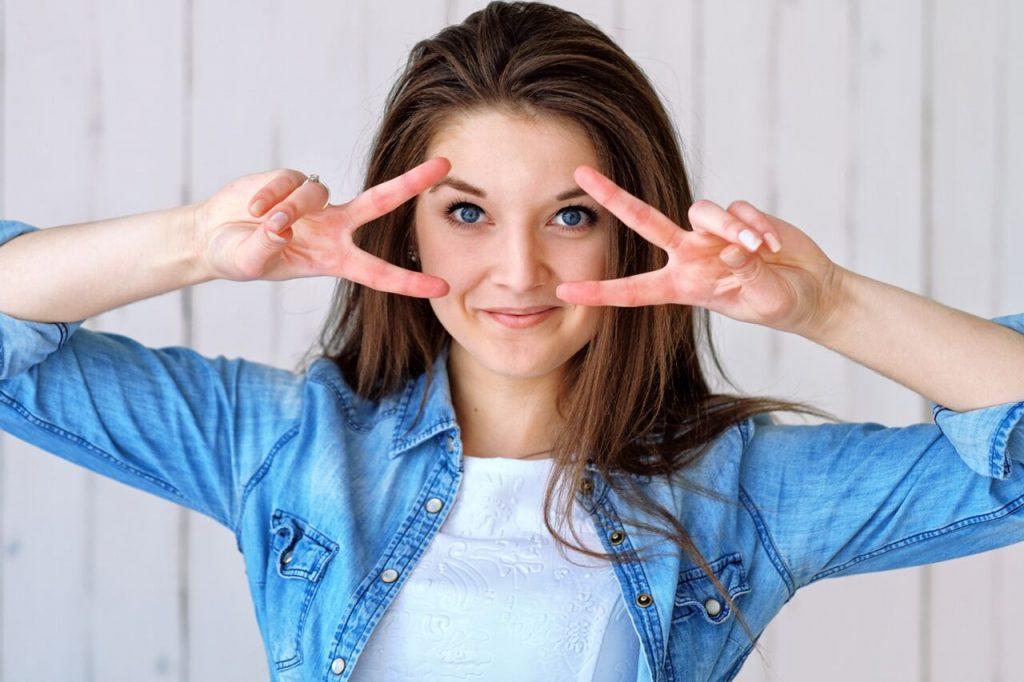 Eye Doctor, Happy Girl Fingers NearEyes with ilasik treatment in Midland, TX.