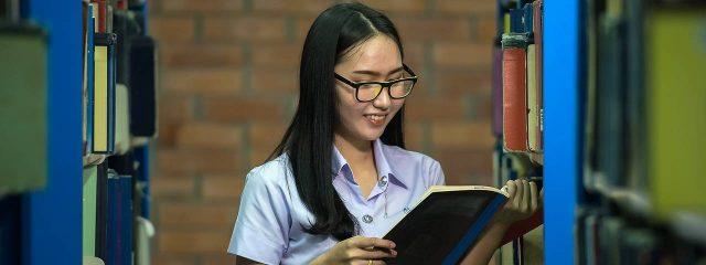 Eye Doctor, asian girl reading in a library in Phoenix, AZ