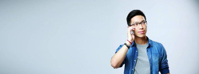 Eye doctor, asian man speaking on his smartphone in Phonenix, AZ