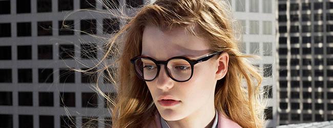 Girl wearing Calvin Klein Designer Eyeglass Frames