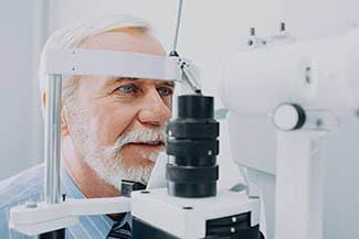 Eye doctor, Senior Patient Receiving Eye Exam in Houston, TX