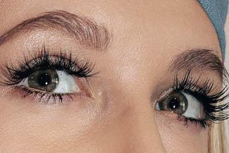 Eye exam, woman with long eyelashes in Houston, TX