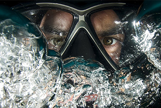 Optometrist, man swimming with specialty eye wear in Houston, TX