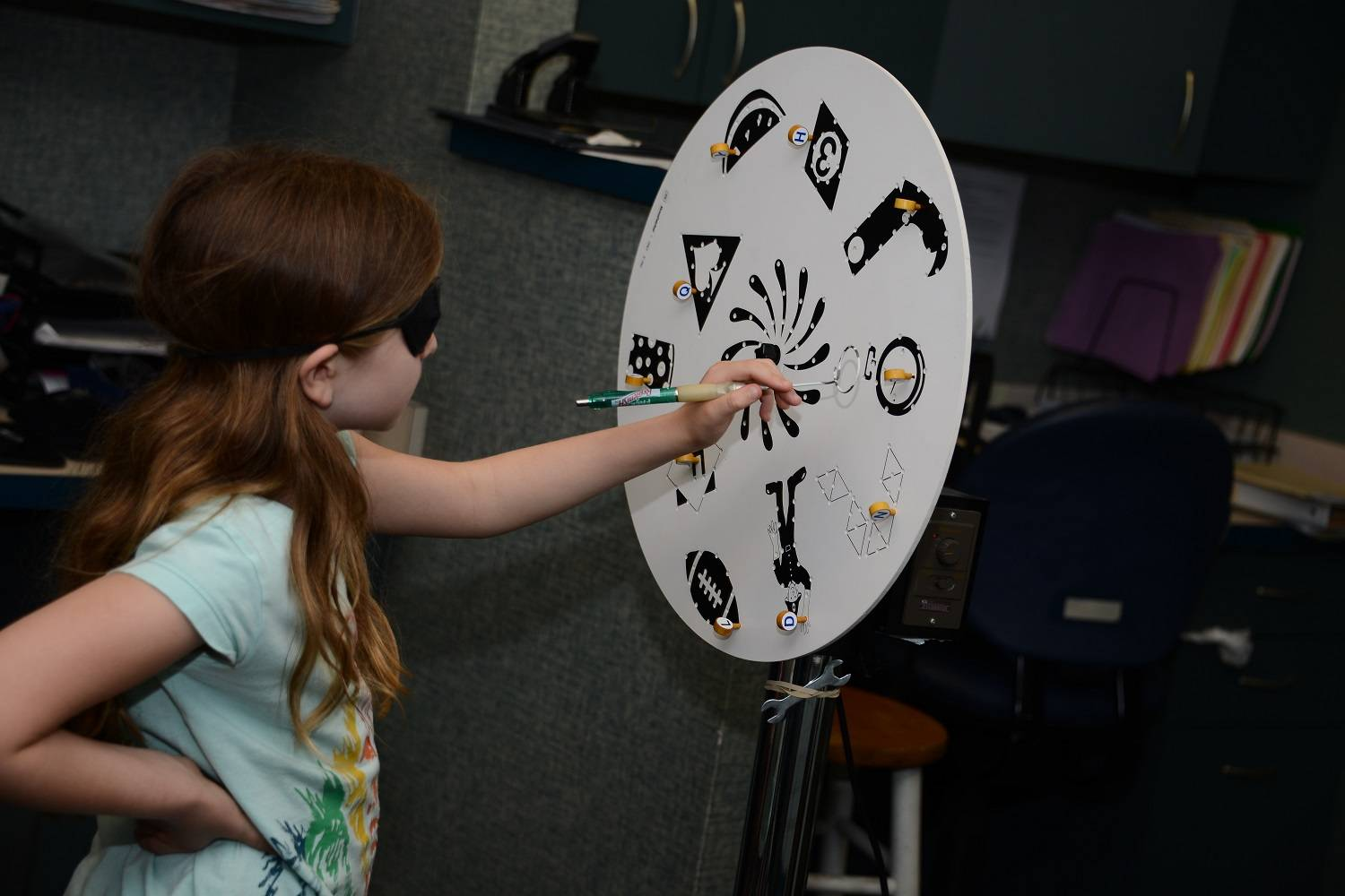 Girl performing eye activity, Eye Care in Bridge, NJ