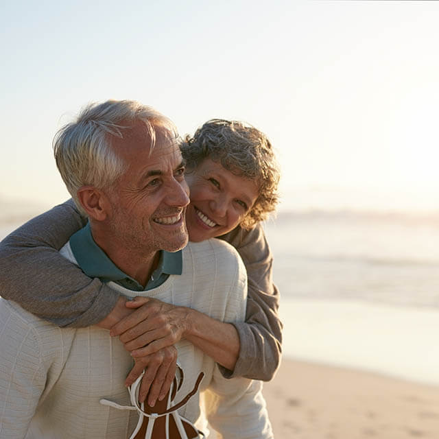 Elderly couple enjoying themselves on the beach