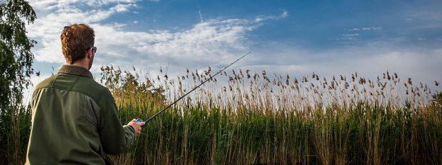 Man wearing sport glasses while fishing
