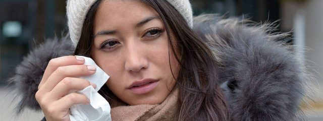 Eye doctor, woman rubbing eyes with tissue paper in Plainview, NY
