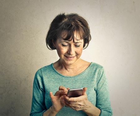 elder woman using smartphone