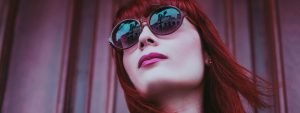 Woman Sunglasses Red Hair 1280x480 300x113