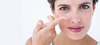 Woman Holding Contact Lens 1280x480 330x150