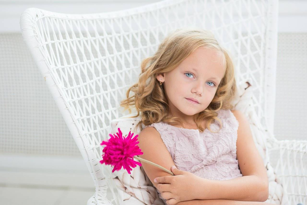 blonde girl pink flower