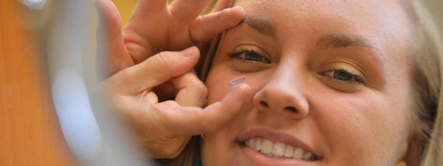 Eye care, girl trying on hybrid contact lenses in Austin, TX