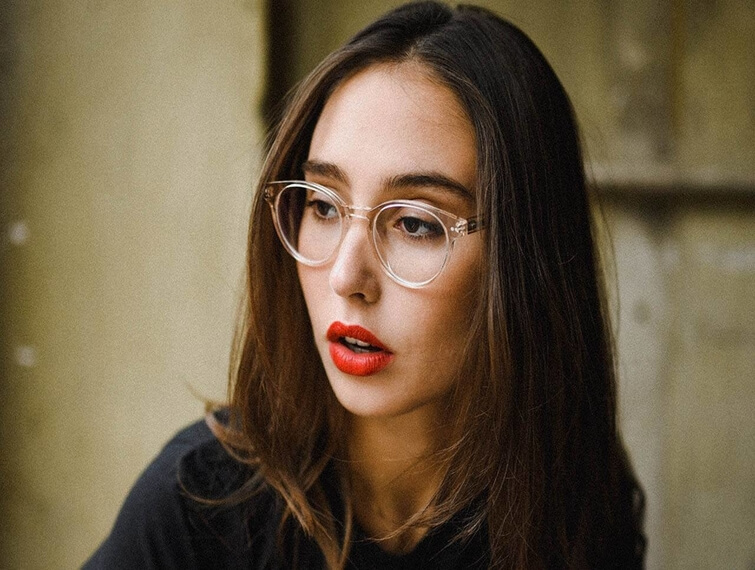 woman clear frames red lips 755x570