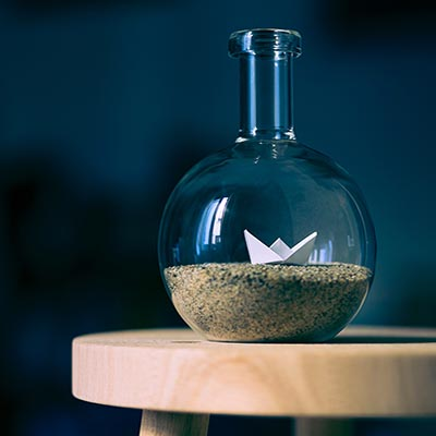 Beaker with sand and origami inside in Lakeville, MN,