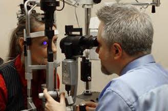 Eye Doctor with patient during eye exam, Burnsville, MN