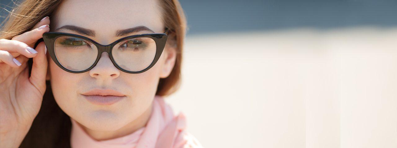 Woman wearing prescription glasses, Optometrist in Burnsville, MN