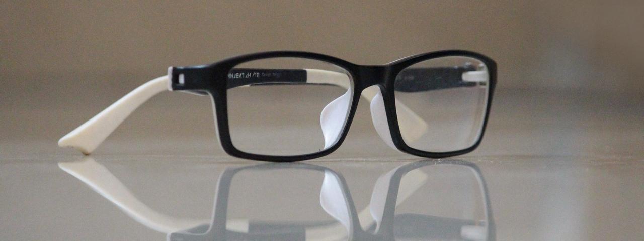 An eye glasses on a table, Eye Doctor in Burnsville, MN