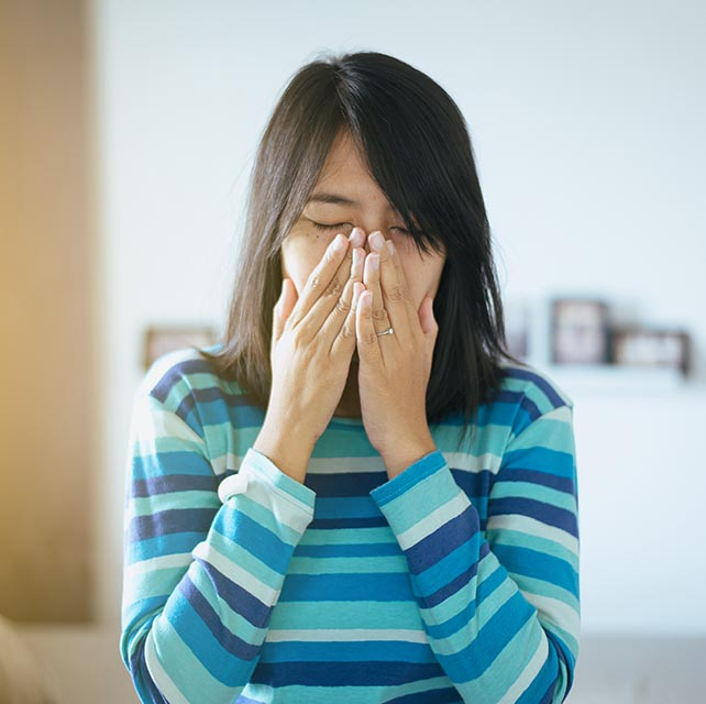 Girl sneezing from allergies in Burnsville, Minnesota,