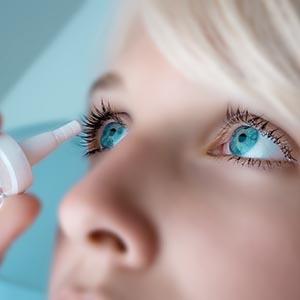 Eye Care, Woman putting eye drops in her eyes in Burnsville, Minnesota,