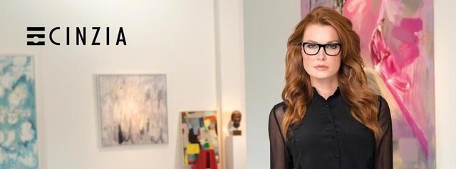 Eye doctor, woman wearing Cinzia Designs eyeglasses in Winnipeg, MB