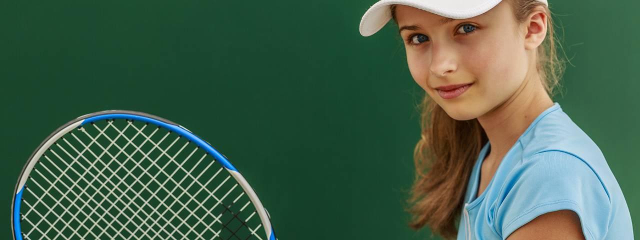 Young girl playing tennis ortho-k lenses