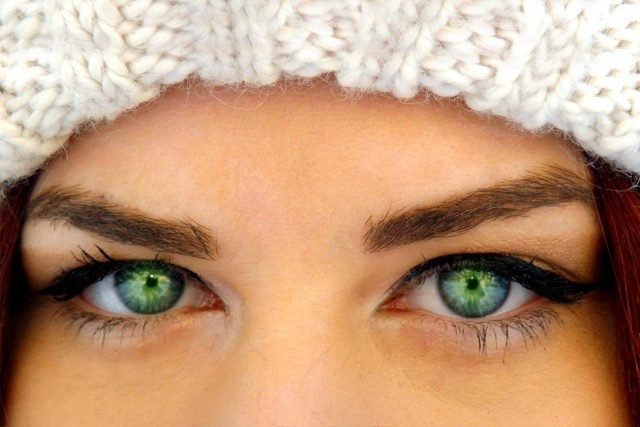 Woman with green eyes and hat, optometrist, eye care, Kissimmee & Lakeland, FL