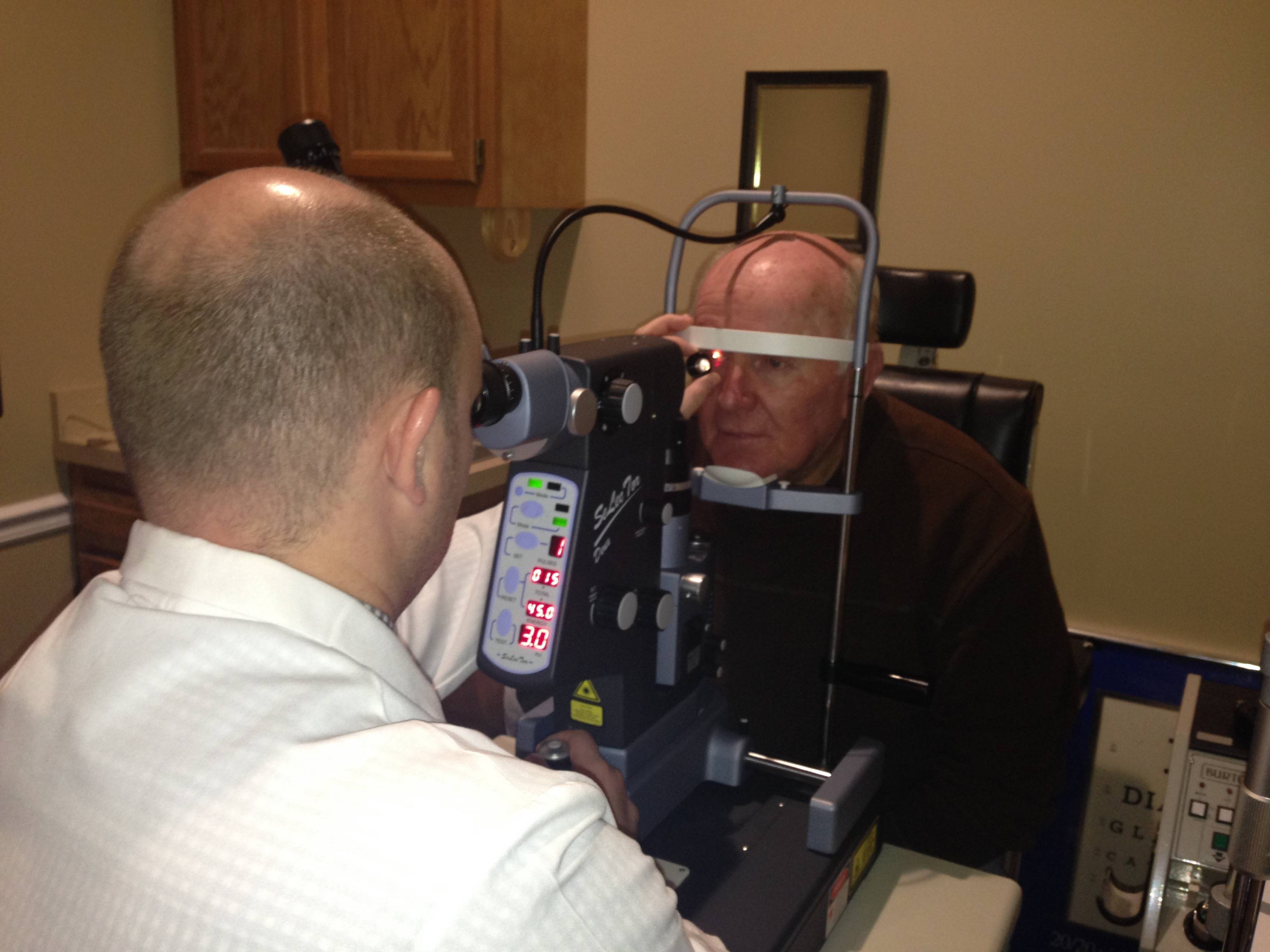 Dr. Burchett & YAG Laser Therapy Equipment