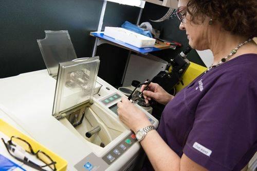Lynn, Lab Technician, edging glasses