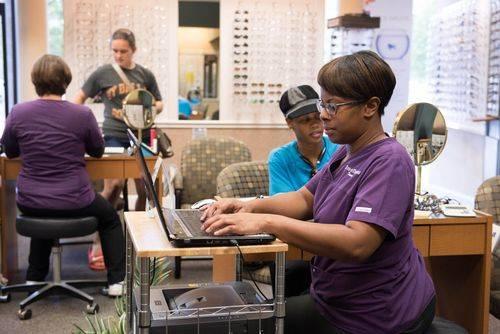 Tianna & Tina, Opticians, assisting patients