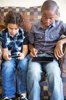 Kids looking at tablets