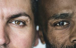 Two different ethnic men's eyes closeup