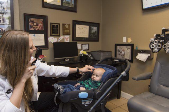 Eye doctor checking baby's eyes