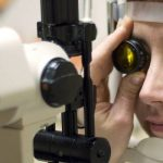 Optometrist, senior woman at a diabetic eye exam in Fairfax, VA