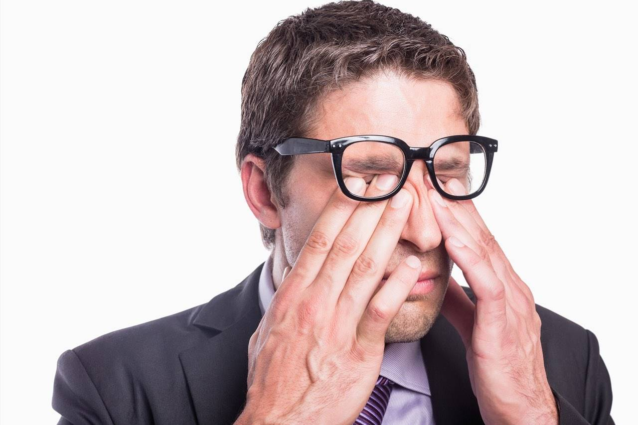 Eye doctor, man rubbing his eyes with eye allergies in Fairfax, VA