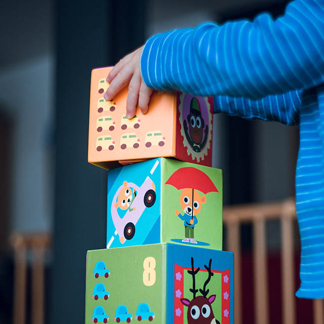 child in kindergarten, with blocks