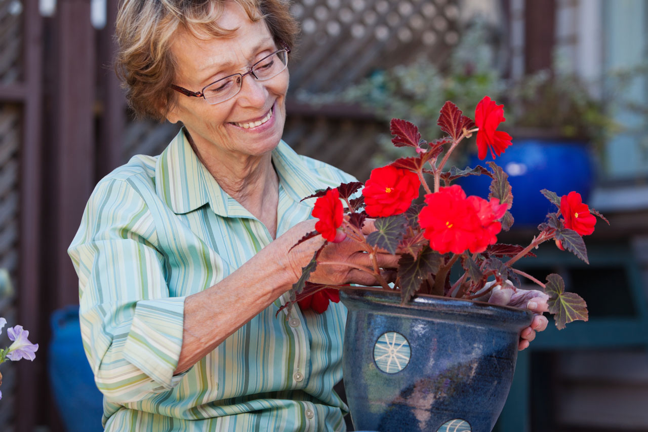 Senior Woman with Flowerpot