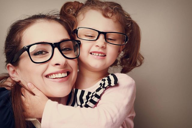 Mother and daughter wearing eyeglasses