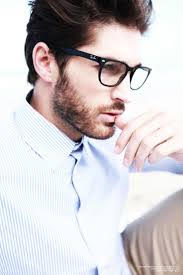 handsome man wearing glasses and looking into the distance