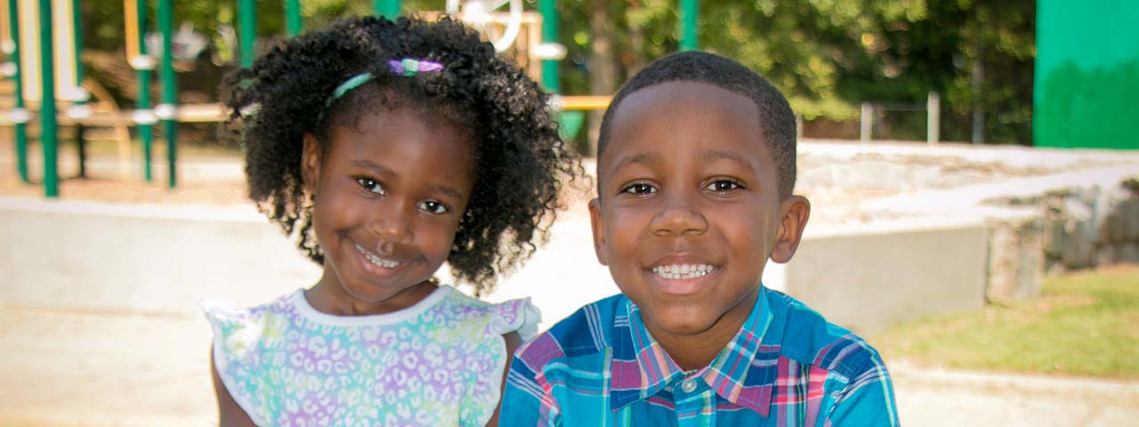 Young children smiling together, Eye care in Providence, RI